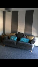 3/4 seater sofa and arm chair grey