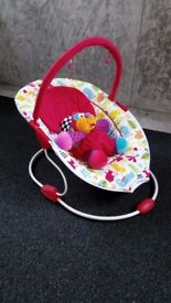 Snuggi Bounce Baby Bouncer with overhead Toy bar, Padding and 3 point harness. From Birth onwards