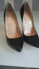 Black loubutin heels
