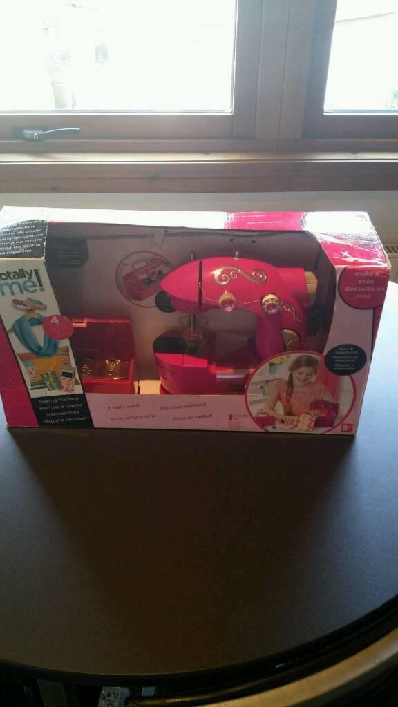 Kids new sewing machine in box