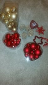 various red and gold christmas tree decorations. 24 gold and 24 red baubles.
