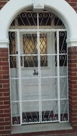 Pair of Wrought Iron Gates with Matching Side & Top Grilles.