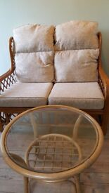 Cane two seater and glass top table