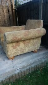 Two arm chairs very comfortable sandy floral design free to collector no rips but well used