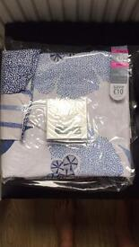 Next blue and white curtains , bedding and cushion