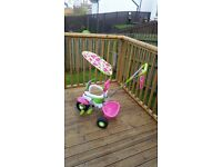 Girls pink/green smart trike excellent condition.