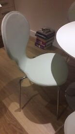 Circular white gloss table with chrome centre leg, 4 white leather look chairs, 1 metre diameter