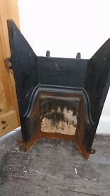 Antique cast iron fireplace insert/backing/fire surround plate
