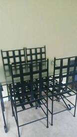 Glass table with 4 black chairs