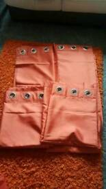2 pairs of orange lined curtains