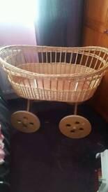 Moses basket on wheels
