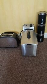 Toaster, fryer and tea coffee and sugar pots.