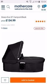 £100 ONO For Sale Graco Evo XT carrycot Black. NEW IN BOX