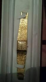 Mens / womens limit international gold plated mechanical watch