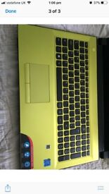 Green large laptop for sale.: basically brand new only been turned on once