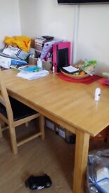 59 inch 36inch solid table and 4 chairs . Chair need coving table extends. Solid wood