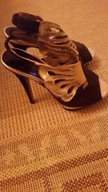 New look black and gold heeled shoes