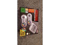 Super Nintendo Mini Classic, over 100 games preloaded, 2 controllers