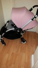 Bugaboo Bee 3 with raincover and soft pink hood