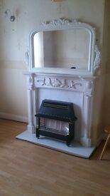 Marble fire place with mirror