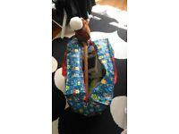 Large toy storing bag with some toys in.
