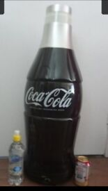 29 inches high coca cola cooler bottle.