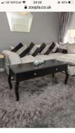 Black wood coffee table with 4 drawers