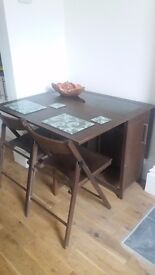 Butterfly Dining Table with 4 Chairs. Offers Welcome