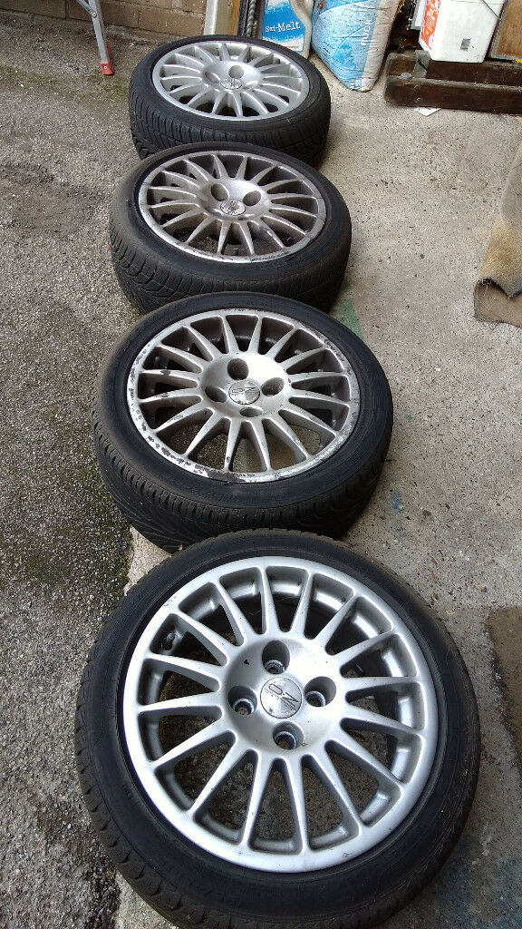 "OZ Alloys (15"") - quite old, with tyres"