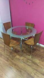 Glass table and 4 wooden chairs