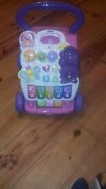 Pink vtech baby walker