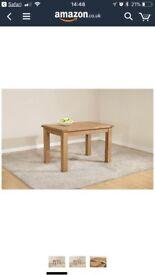 Extending oak dining table - brand New