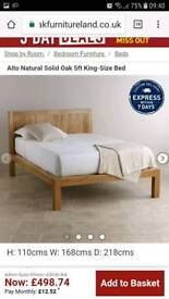 Brand new, never been used king size oak bed frame