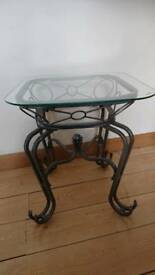 Glass topped metal side table
