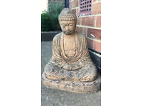 Buddha - sand coloured Buddha who has an aged look from being in the garden, 17 inches high