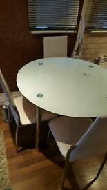 White chairs and dinning table