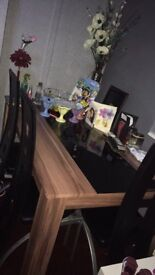 Great condition dining table and 4 chairs contact me on 07463757144