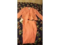 Light pink, slim fit suit size 10 with tags