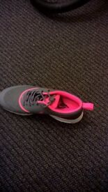 1 pink pair of nike trainers