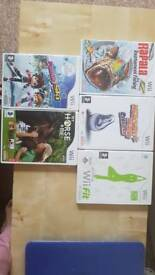 Nintendo Wii, with Wii fit board, controllers and games