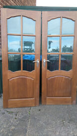 Pair of solid Oak and glass panel doors for sale.