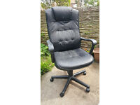 Large Black office chair with arm rests