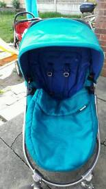 blue and turquoise mamas and papas rubix pram