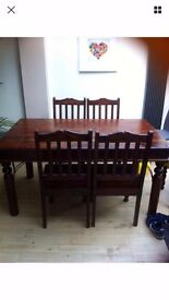 Indian wood dining table + 6 chairs - very good condition -