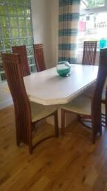 stone / marble dining table and 6 mahogany chairs