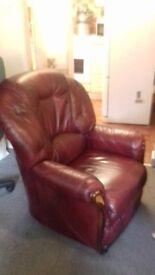 Burgundy-coloured, leather-effect armchair