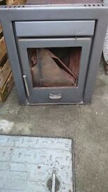 Solid fuel stove insert