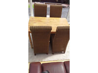 Dinning table and 4 rattan chairs
