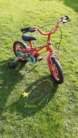 Lightening McQueen kids bike with stabilizers, good condition