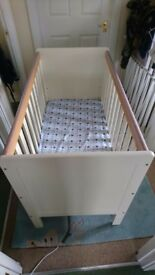 Selling baby cot with drawer underneath